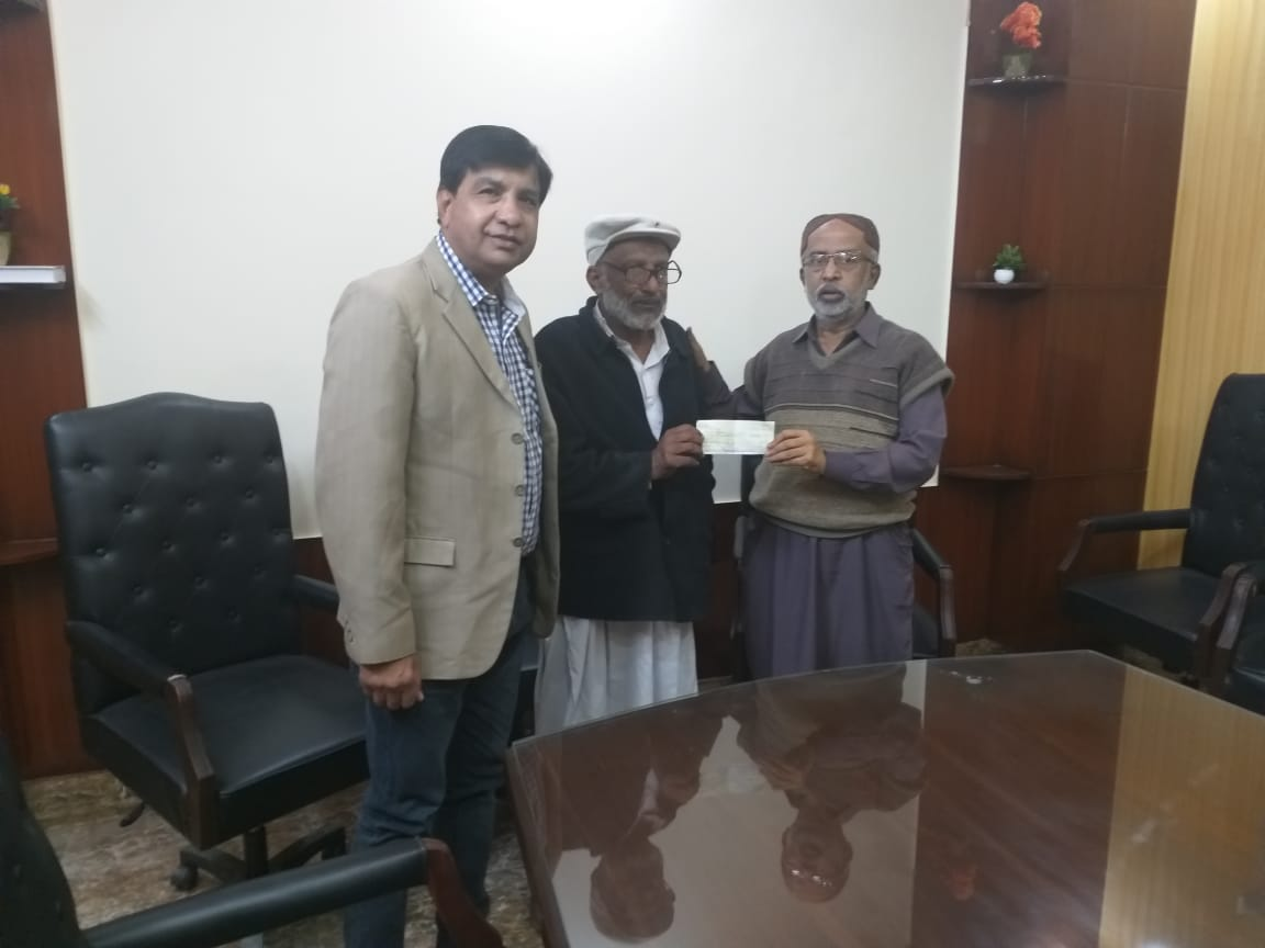 Handing over Cheque to Mr. Abdullah Agheem Farmer of FFS R. D. 99.5 L/S Akram Wah on 24/01/2019